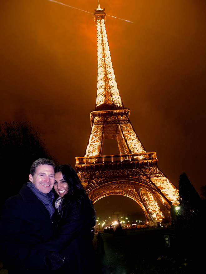 Photo of couple in front of Eiffel Tower in Paris