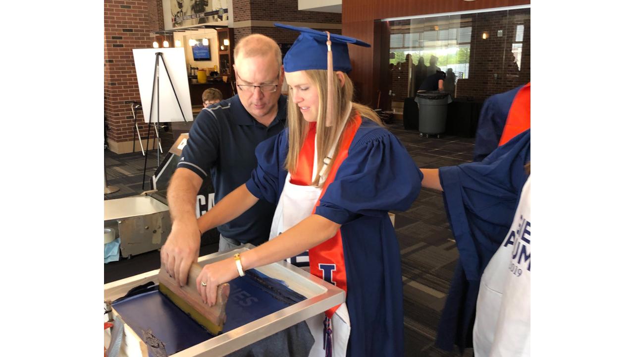 Live screen printing at University of Illinois' 2019 graduation ceremony