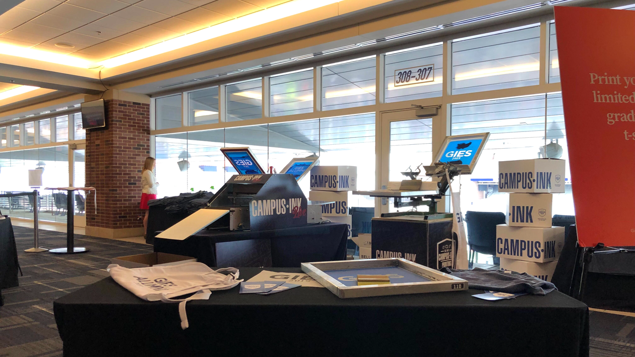 A live screen printing setup at University of Illinois' 2019 graduation ceremony
