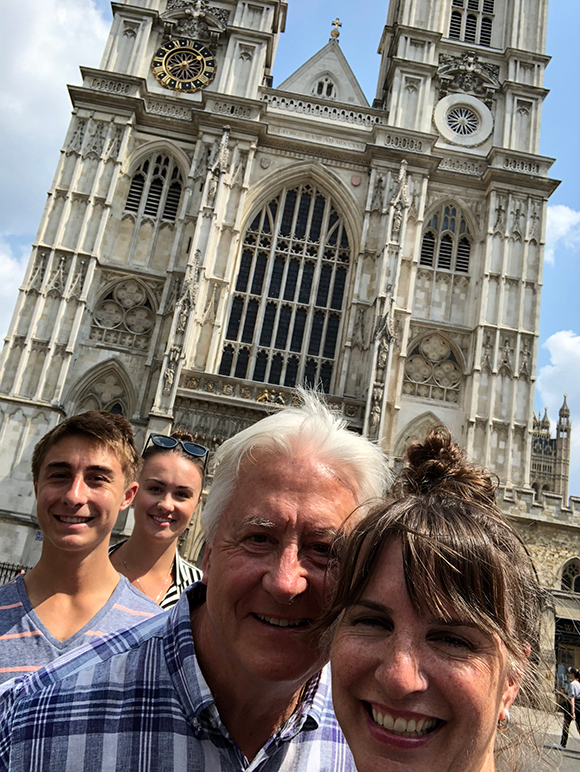 Photo of family in front of Westminster Abbey in London