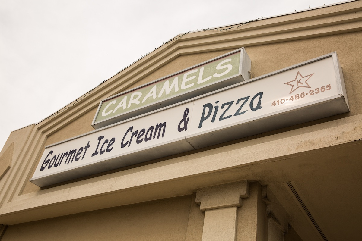 The sign for Caramels Gourmet Ice Cream & Pizza in Baltimore, MD