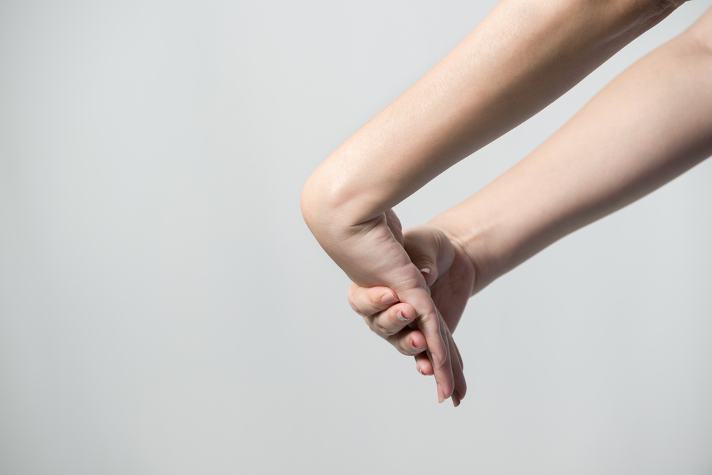 stretching hand from technology related injuries