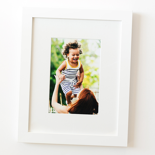Baby photo in white Irvine frame