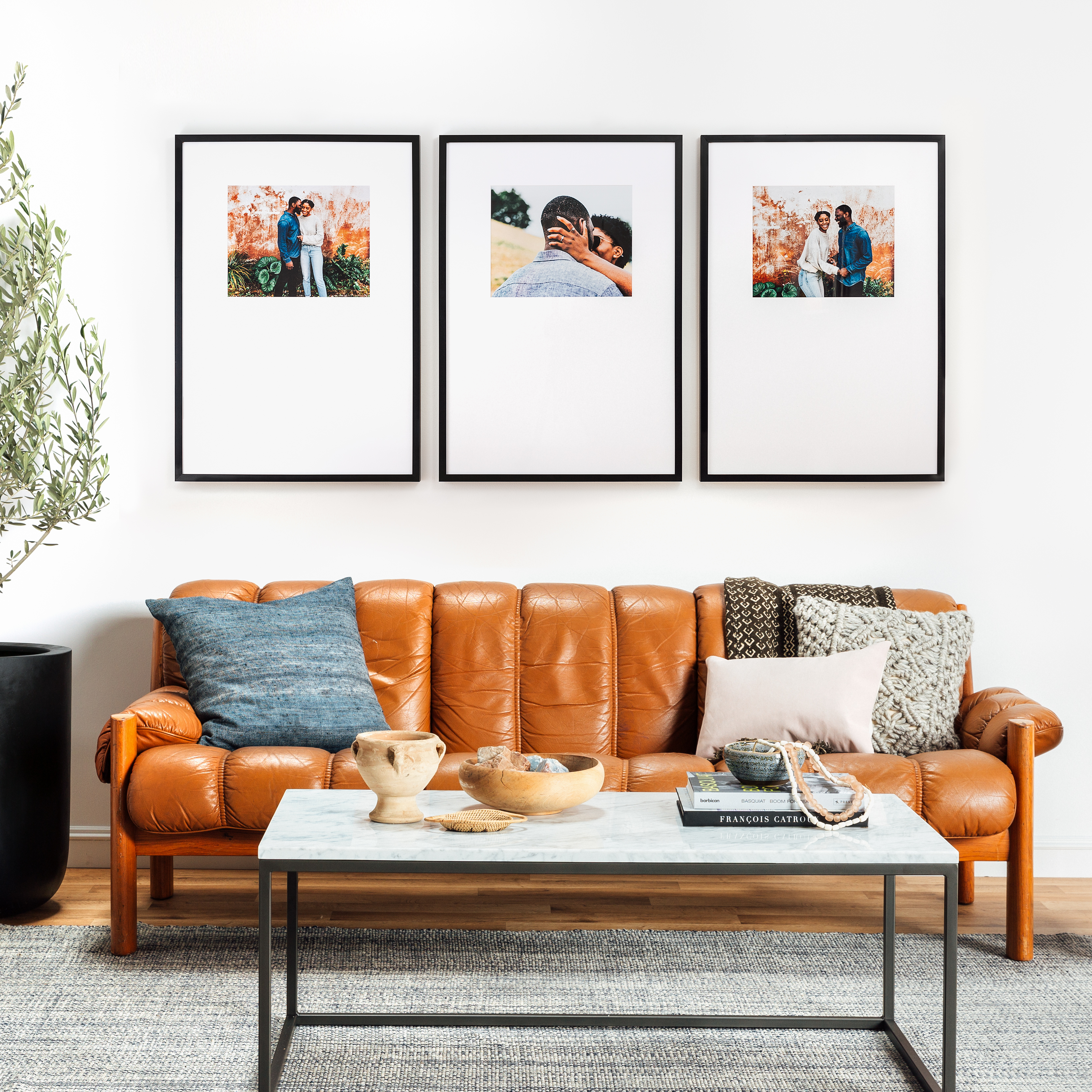 Framebridge Triptych gallery wall in black above couch