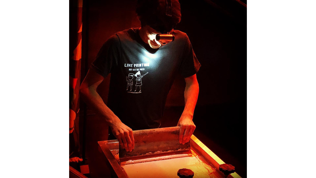 Live screen printing (in the dark) with a headlamp on.