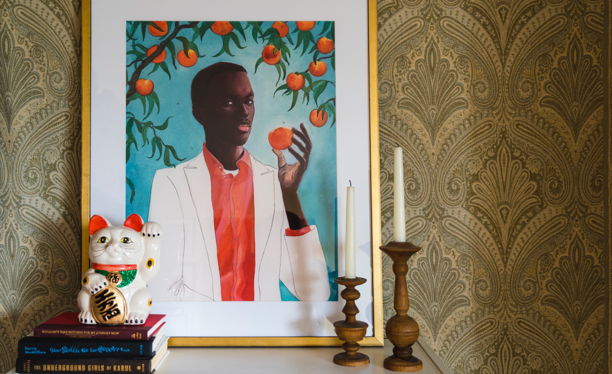 man with peach in gold frame