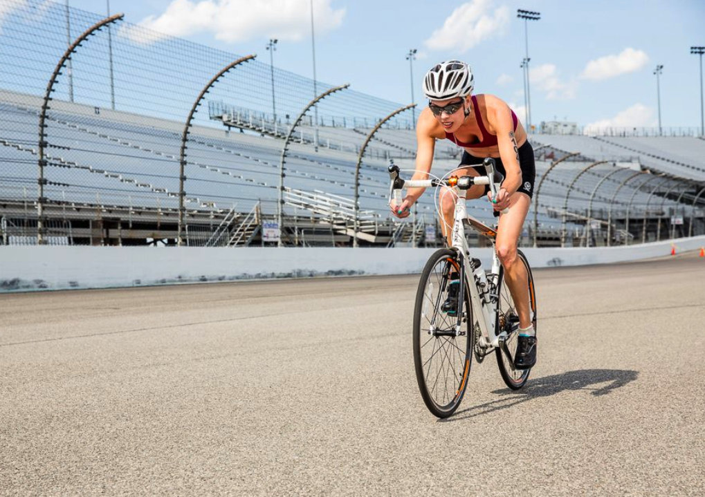 A member of Team Endless Pools cycling at the REV3 Triathlon in Richmond, Virginia