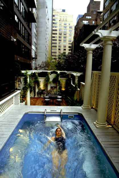 a swimmer in an Endless Pool on a Midtown Manhattan rooftop