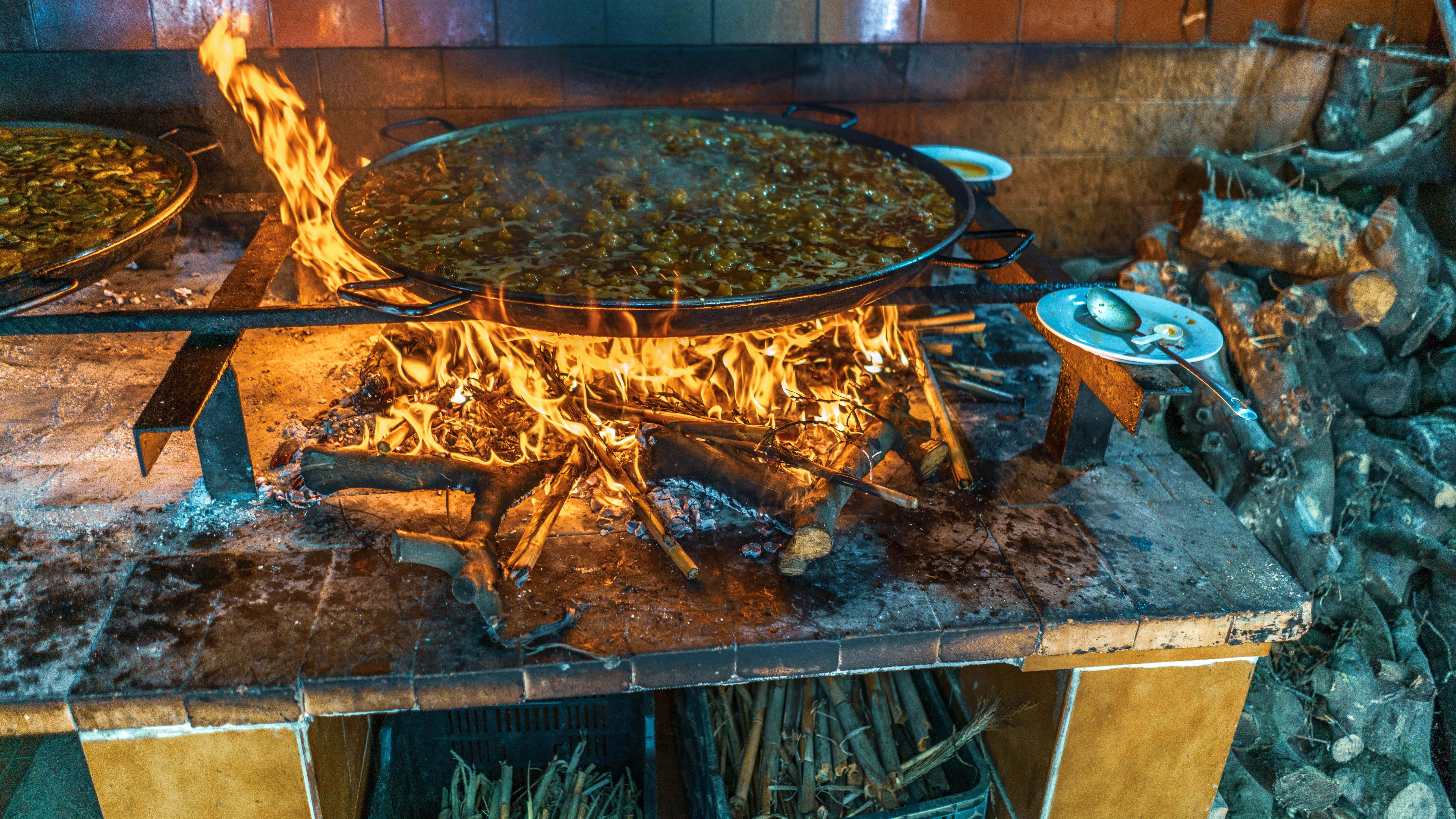 Indulging in traditional paella from Valencia is one of the best things to do in Spain