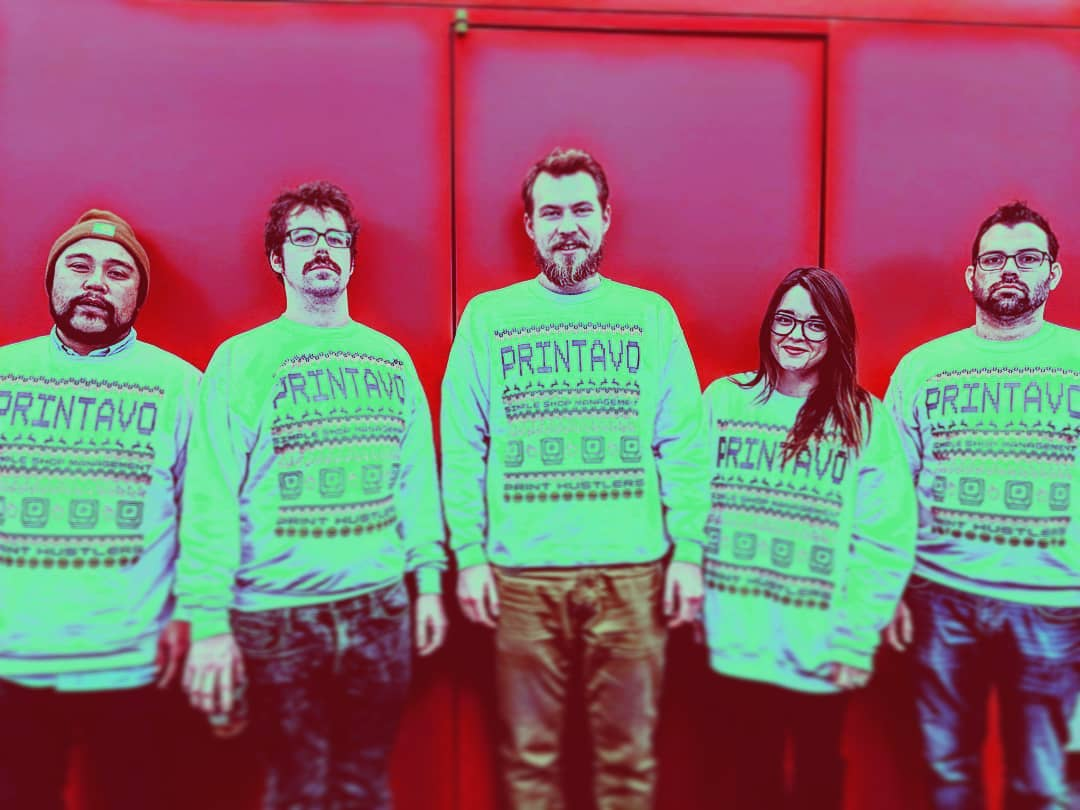 Some of Printavo's team in their holiday sweaters