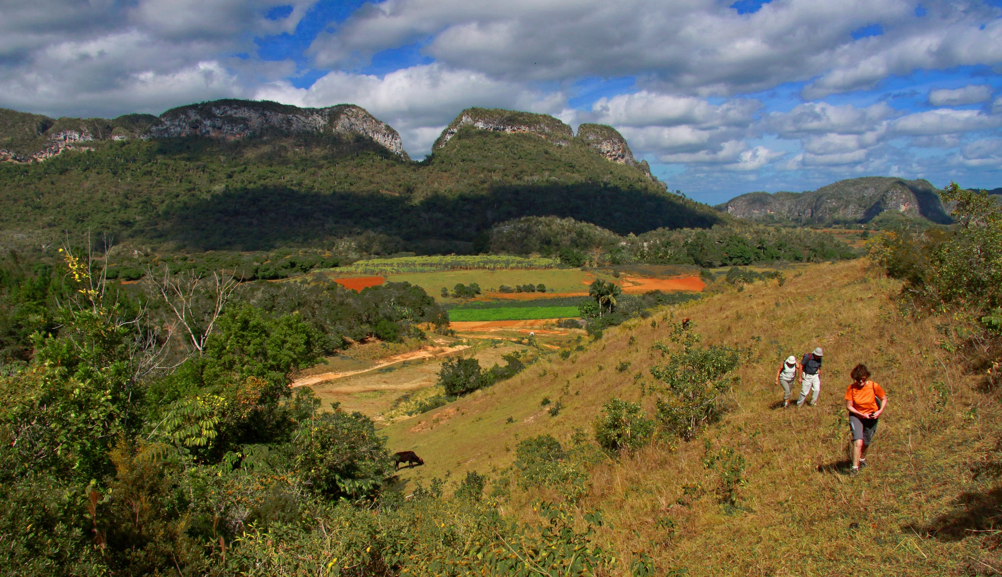 Clouds and grass-covered mountains in Vinales Cuba's 7 Wonders
