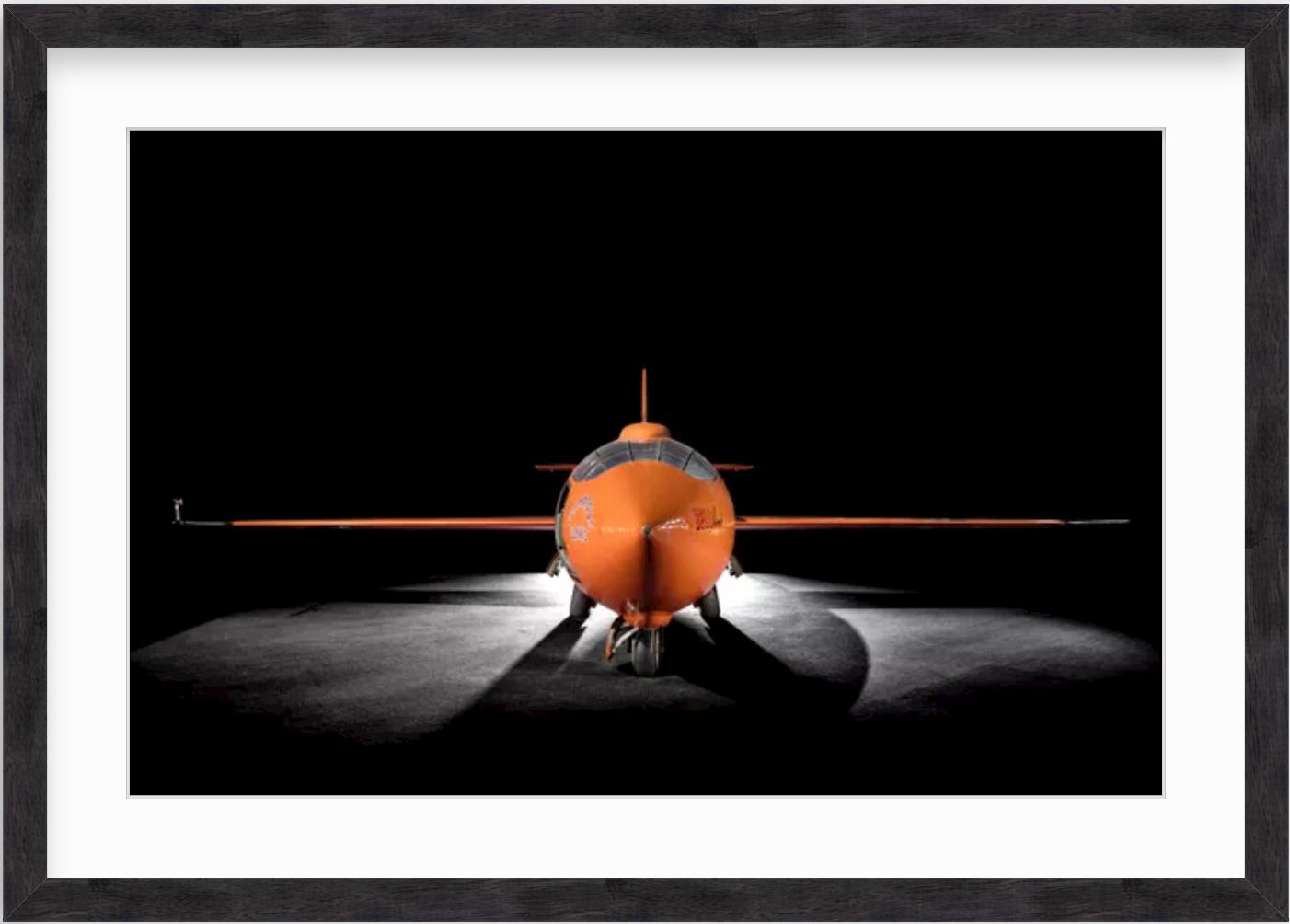 photo of airplane in black wood frame