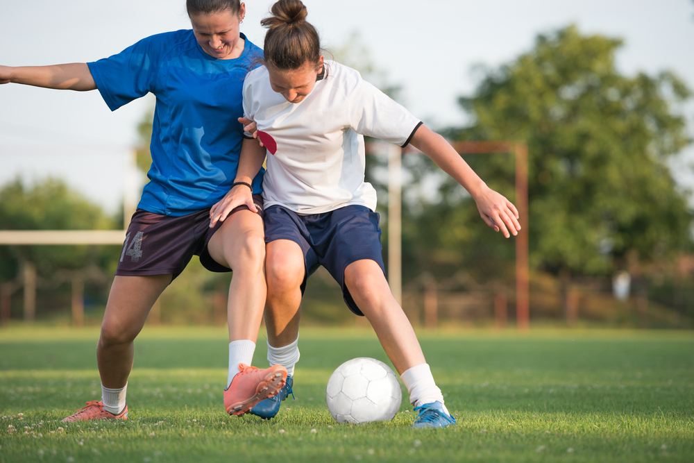 acl injury prevention - playing soccer
