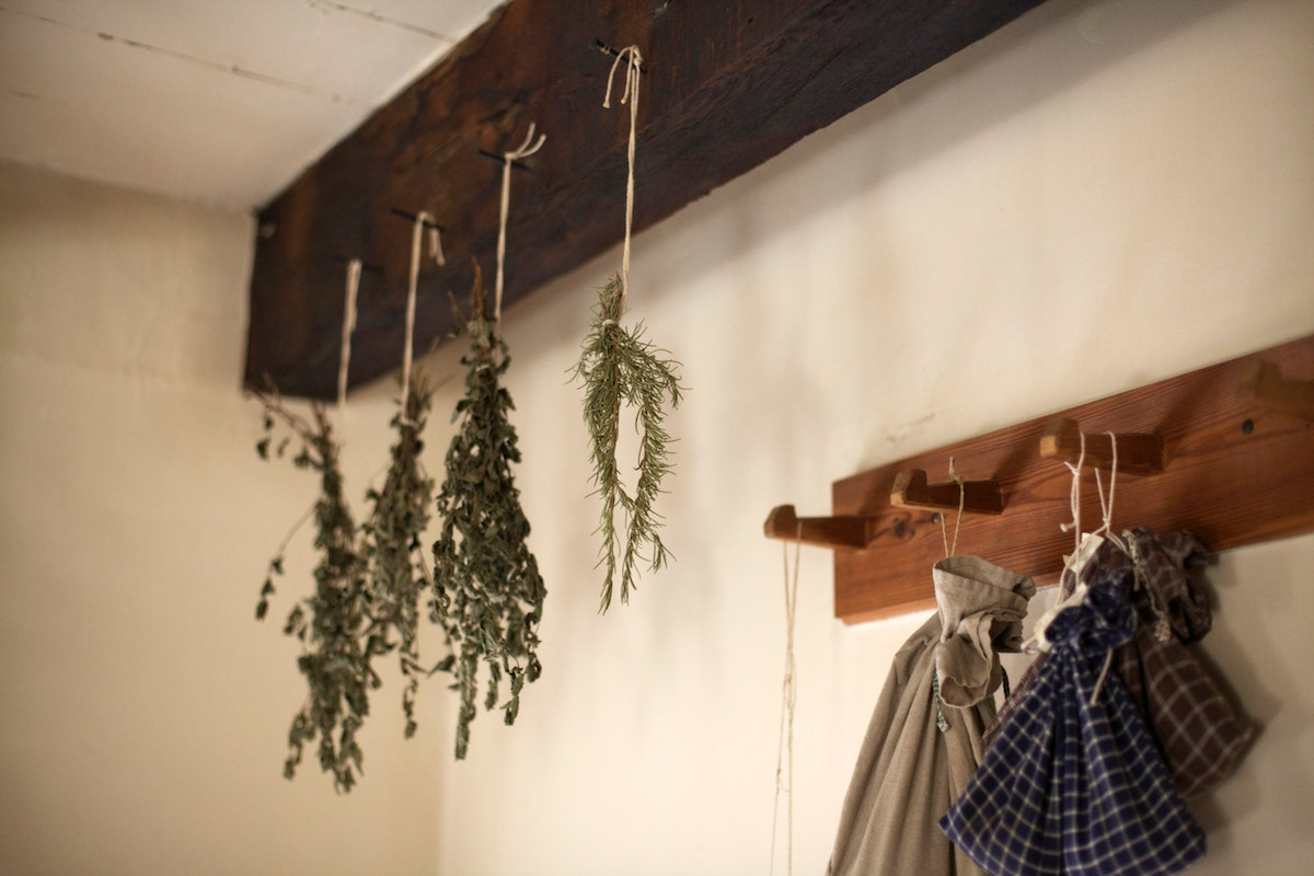 herbs hanging in a kitchen
