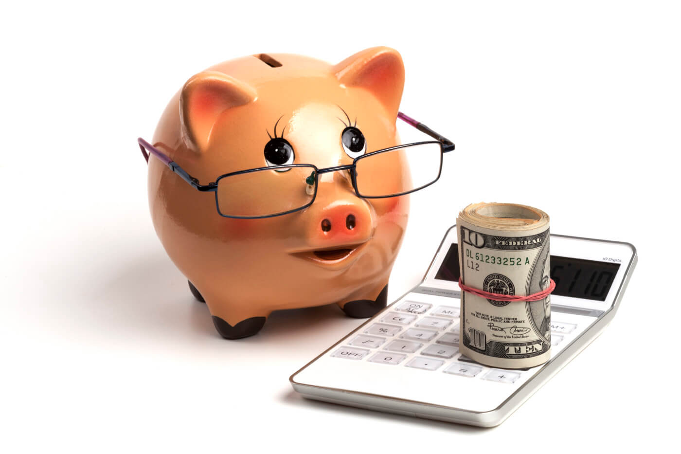 piggy bank with money and white calculator
