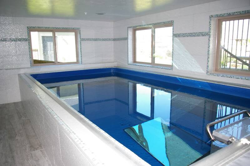 The compact Endless Pools® installation used for year-round therapy in a sunroom