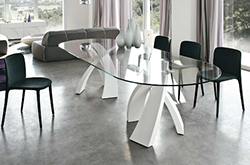 oval-shaped-glass-dining-table-with-white-base.png