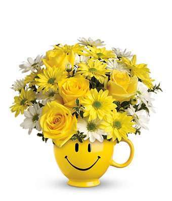 Yellow and White Flowers in Smiley Face Mug