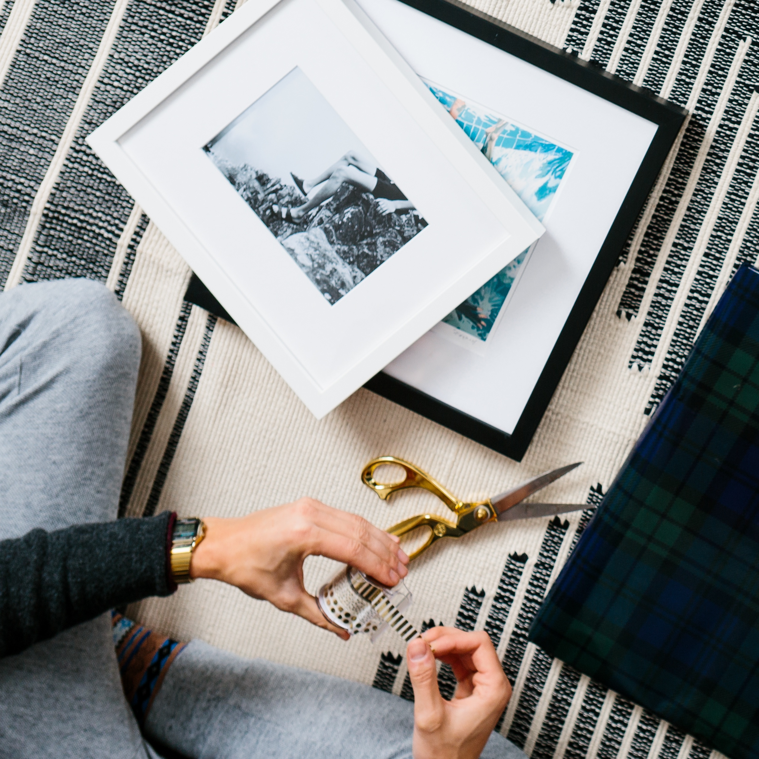 measuring frames on a cozy grey rug