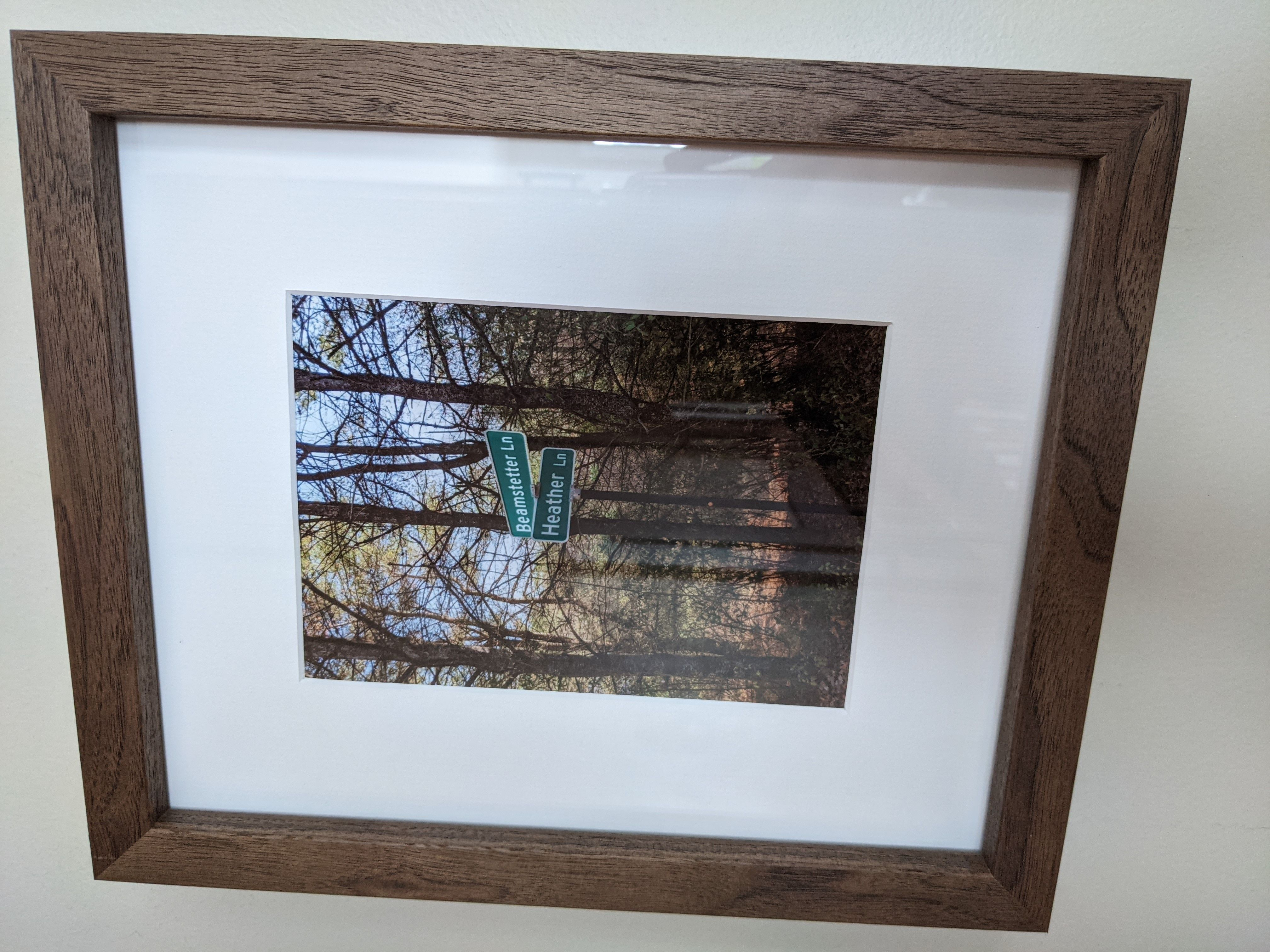 wood frame with street sign intersection photo