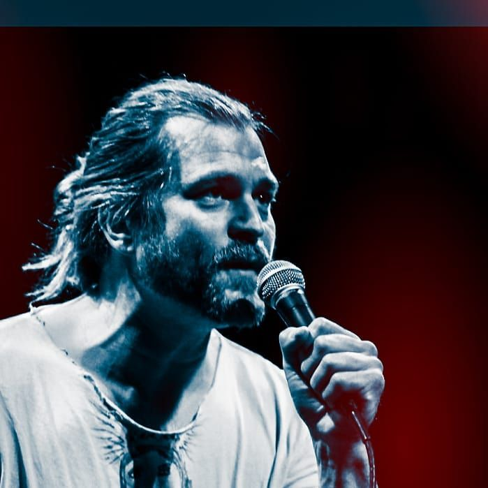man singing at microphone