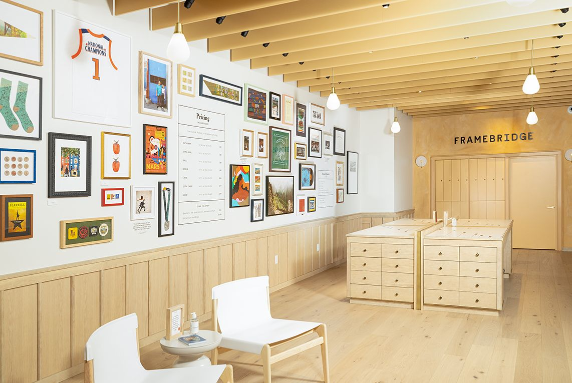 photo of store with gallery wall of frames