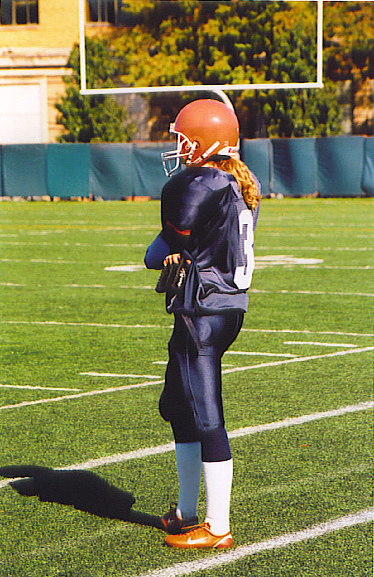 Photo of woman playing football