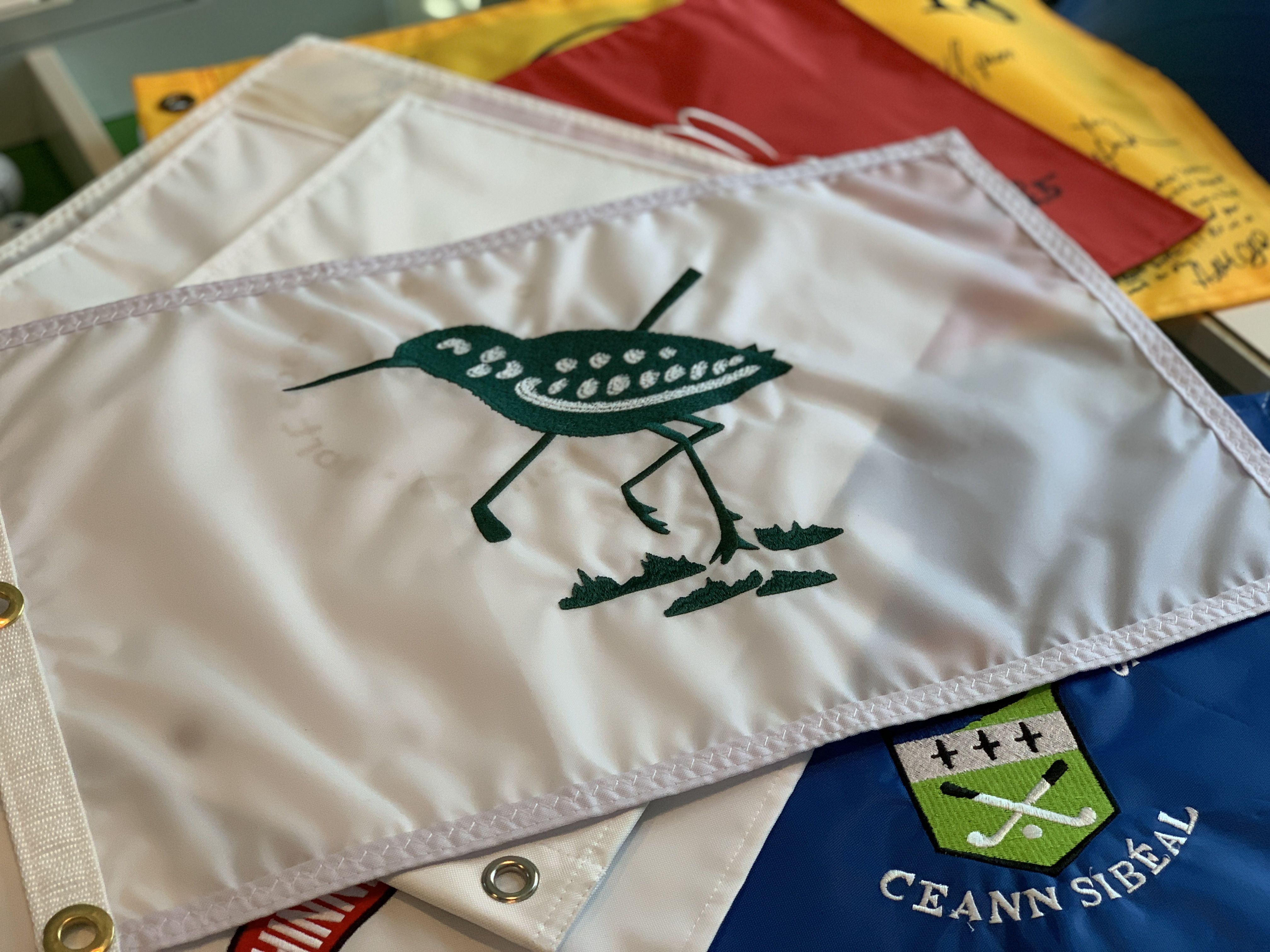 golf flag with bird