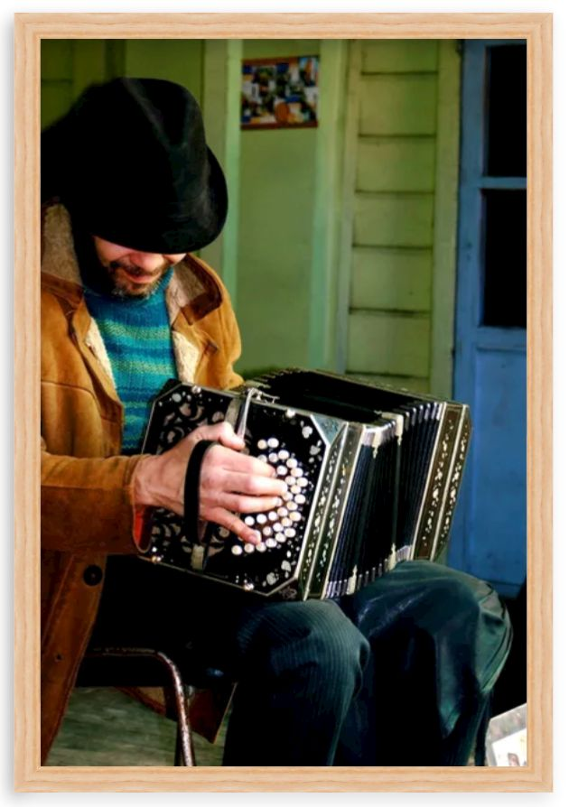 photo of man with accordion in wood frame