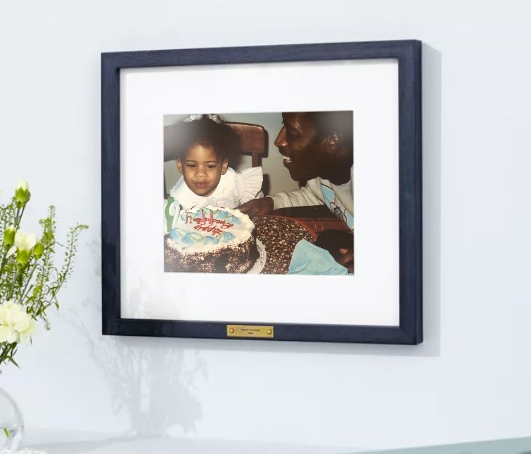 framed photo of dad and daughter with birthday cake