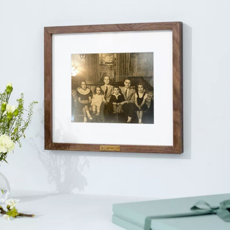 old family photo in wood frame