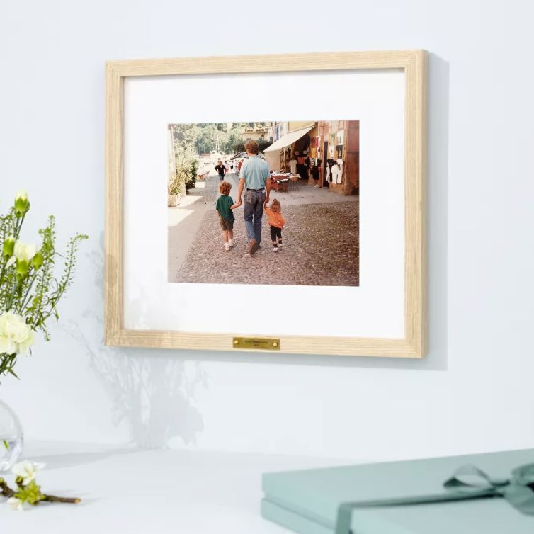 framed photo of dad holding hands with kids