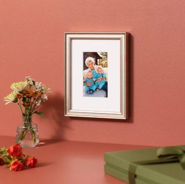 frame of grandma holding twins