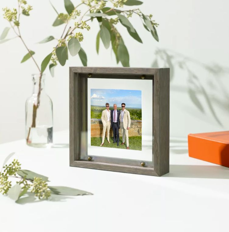 photo of dad and sons in suit in frame