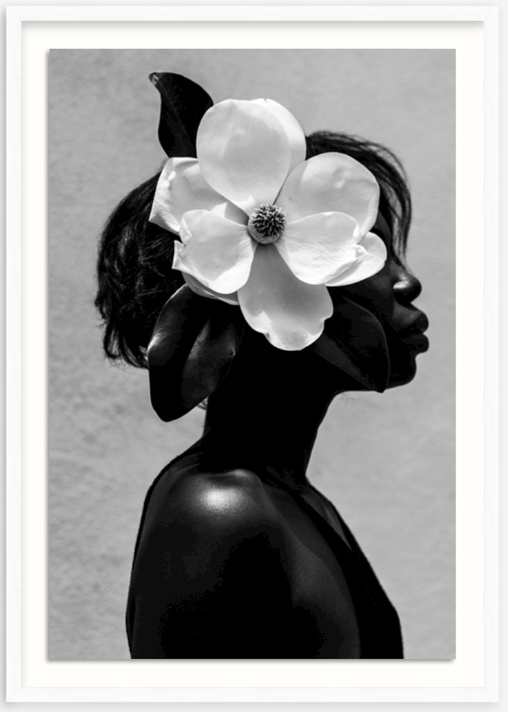 framed black and white photo of woman with magnolia