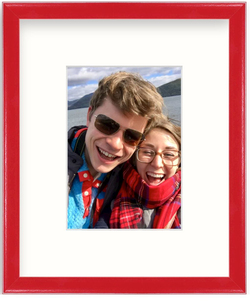 selfie photo of couple in red frame
