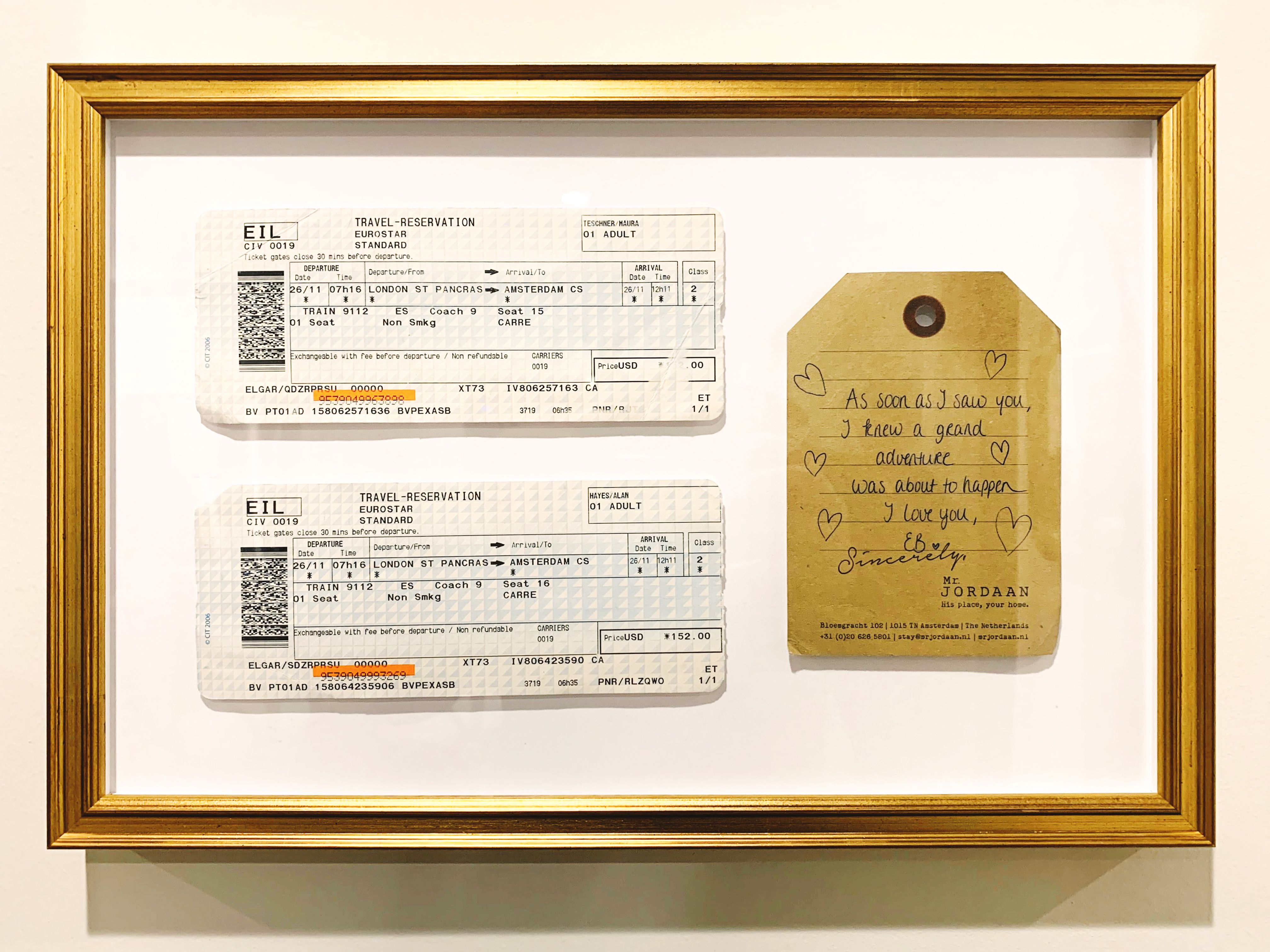train tickets and note in gold frame