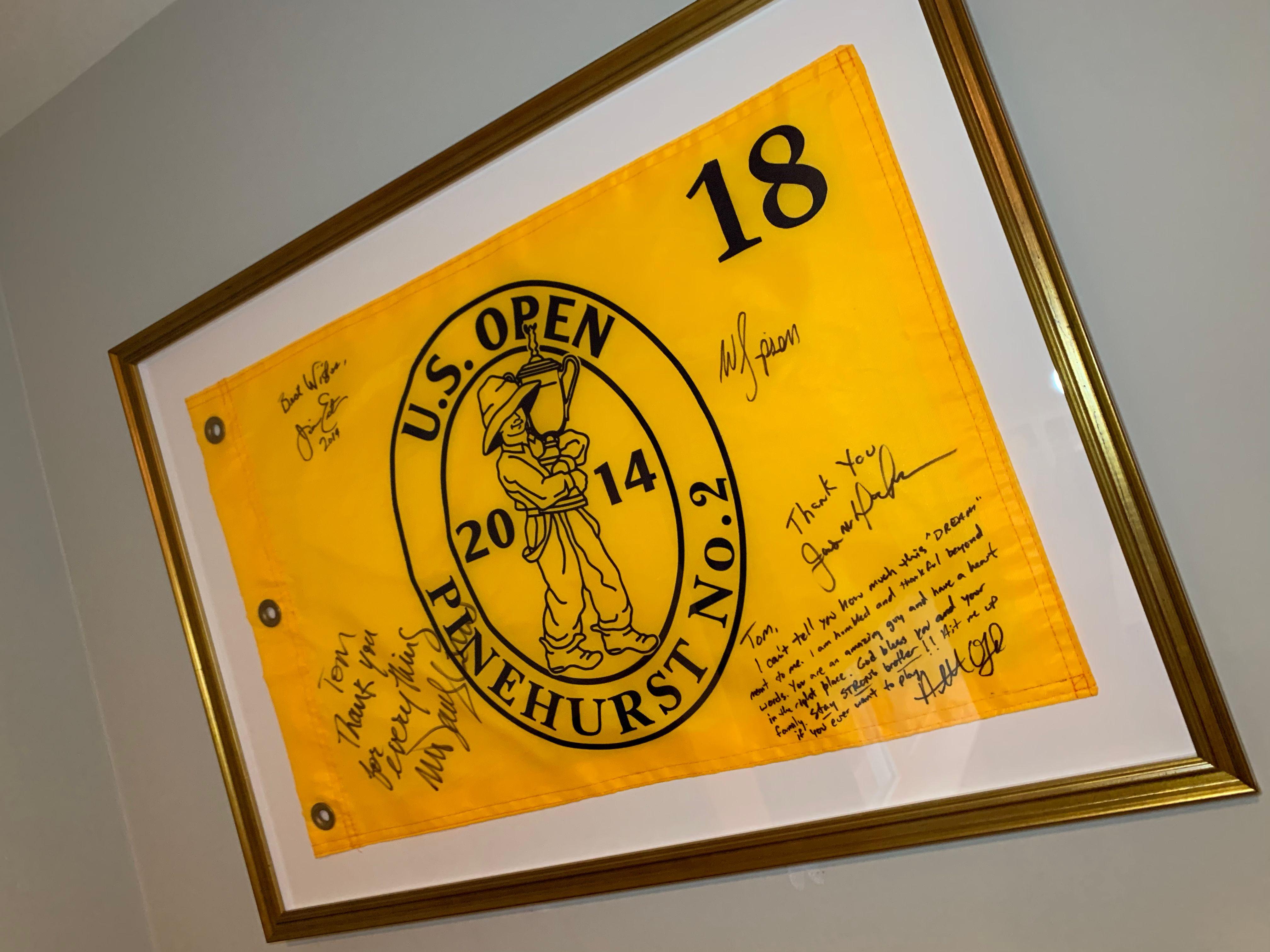 signed golf flag in frame