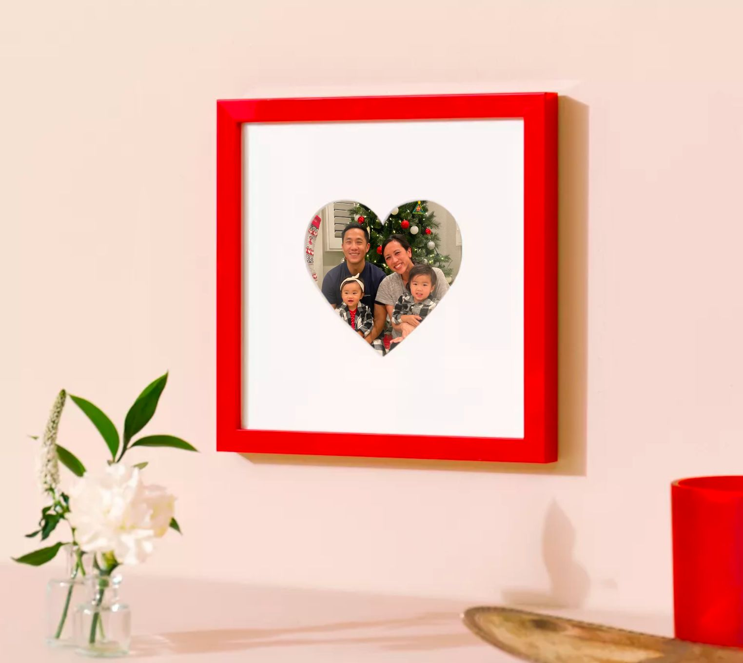 red frame with heartshaped mat and photo of cute family