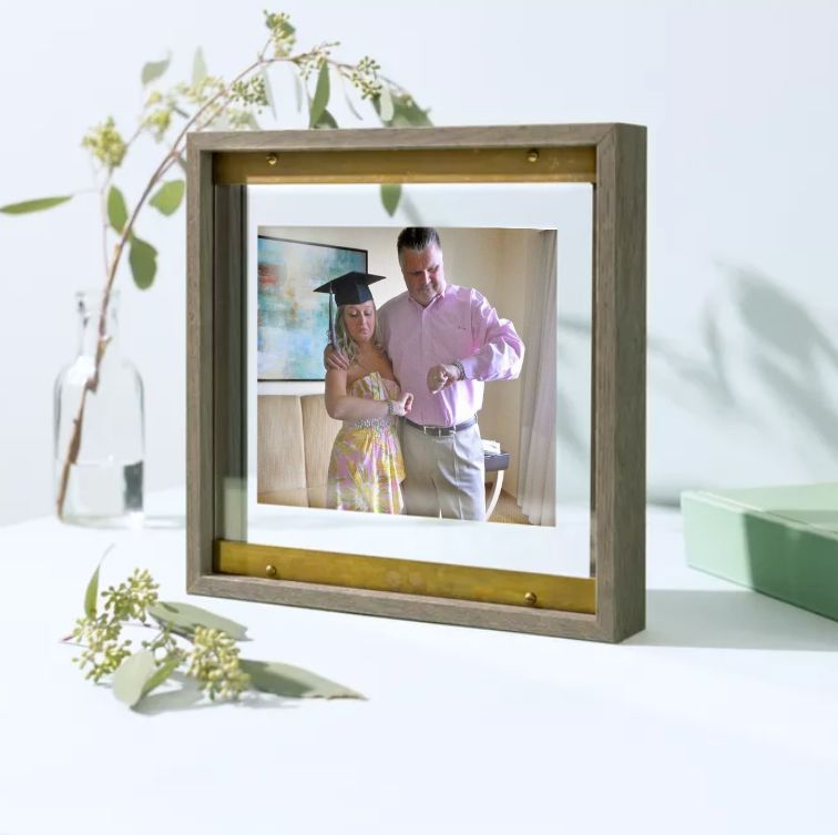 framed photo of dad and daughter checking watches
