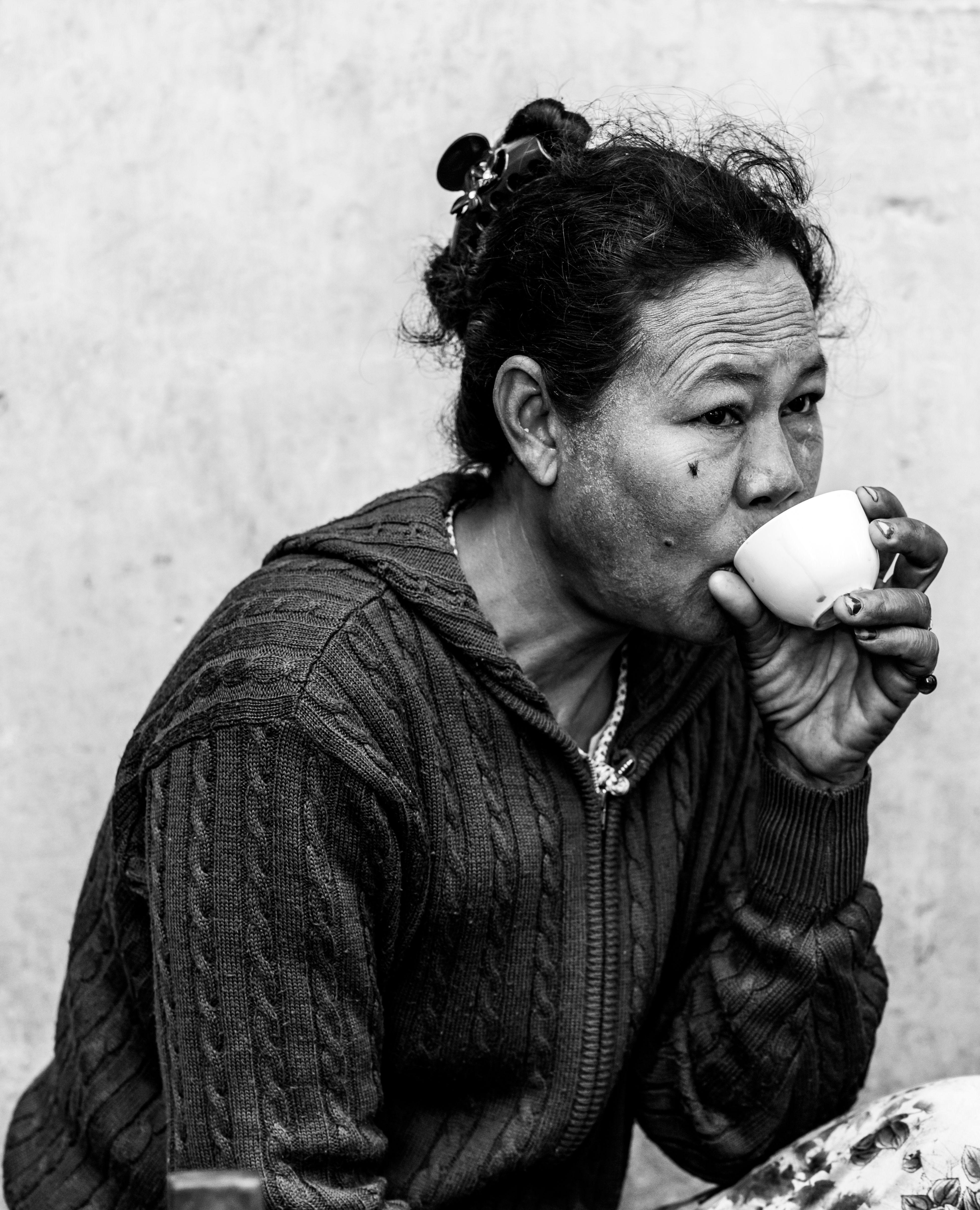 Woman drinking coffee in myanmar