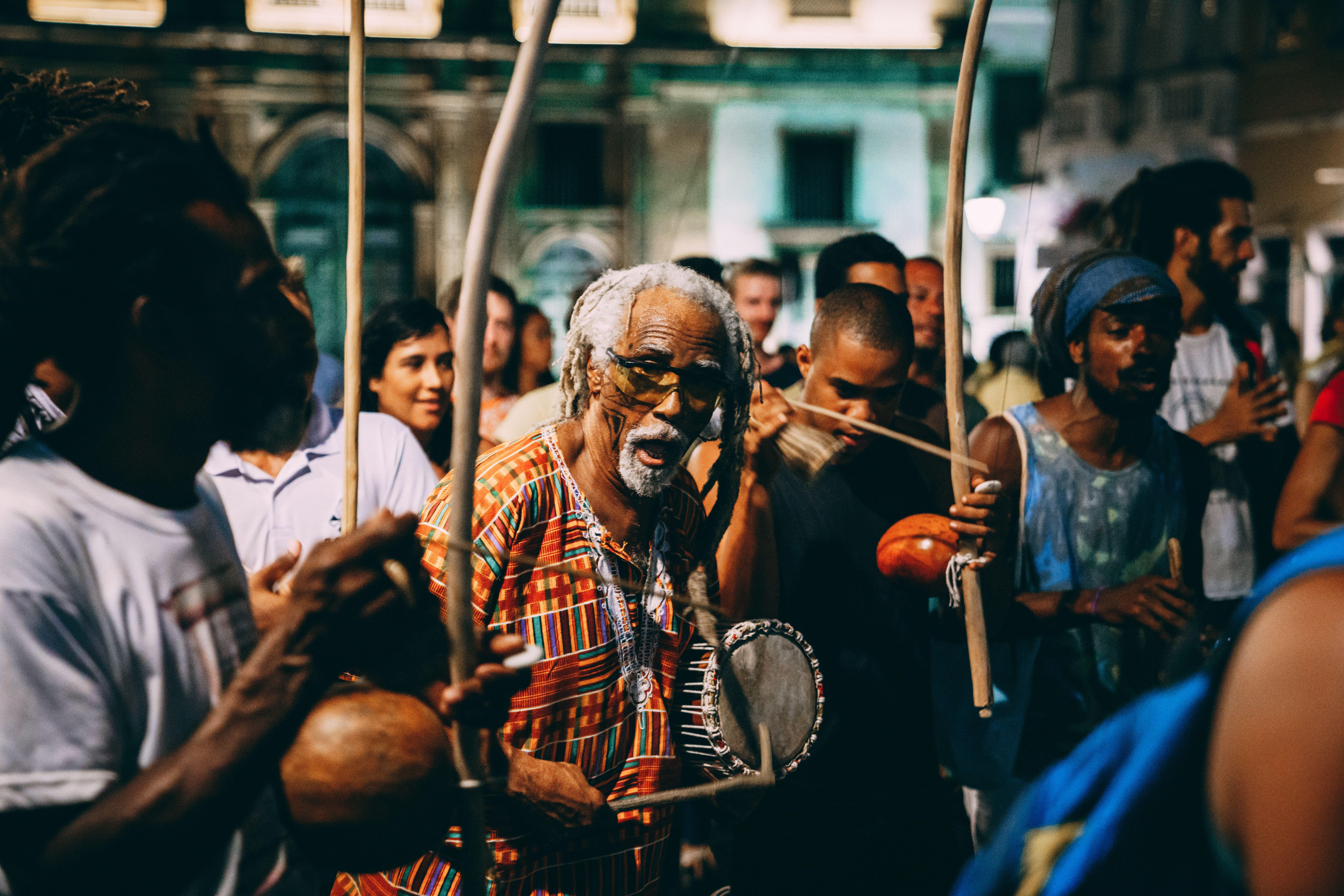 men in drum circle in brazil