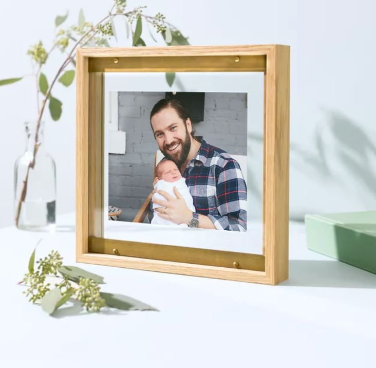 photo of dad holding baby in a frame