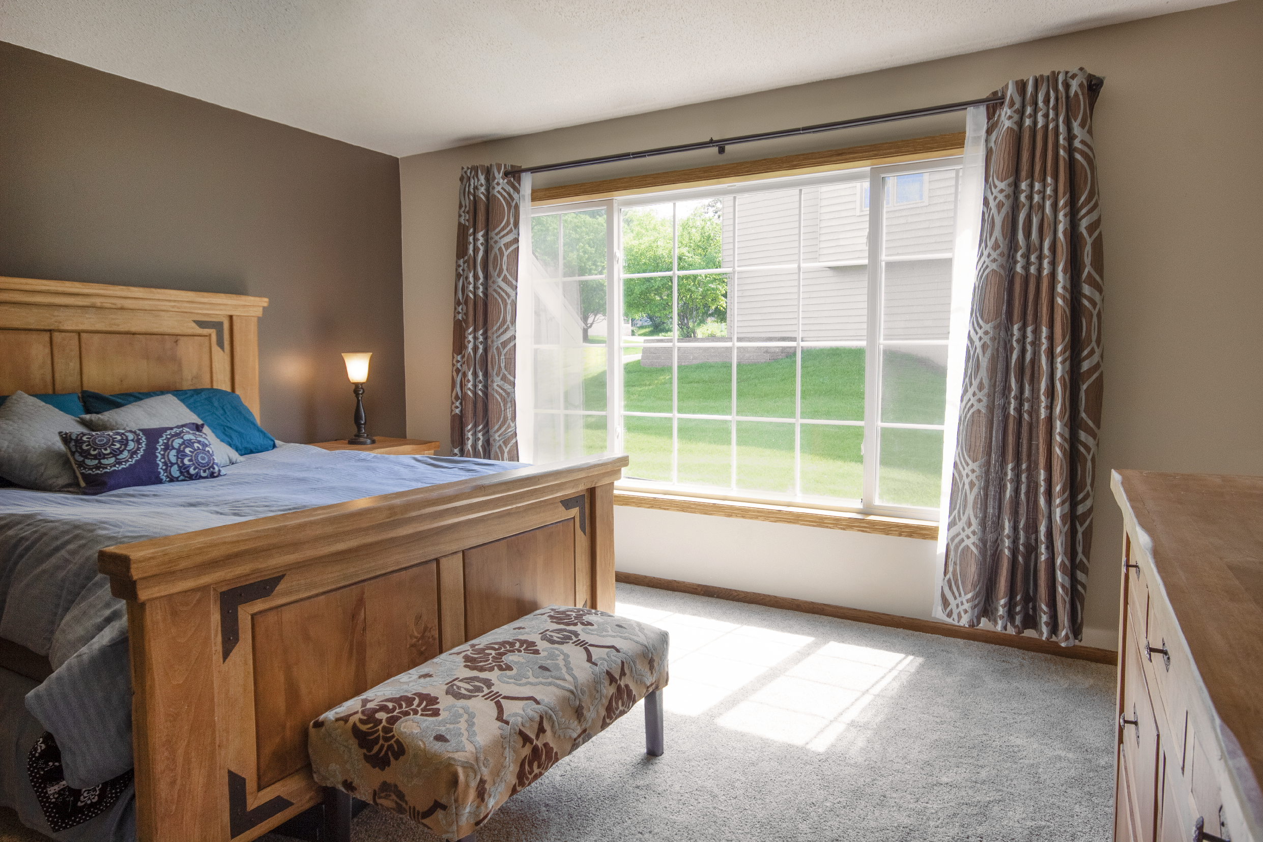Bedroom with bed and Infinity from Marvin slider window
