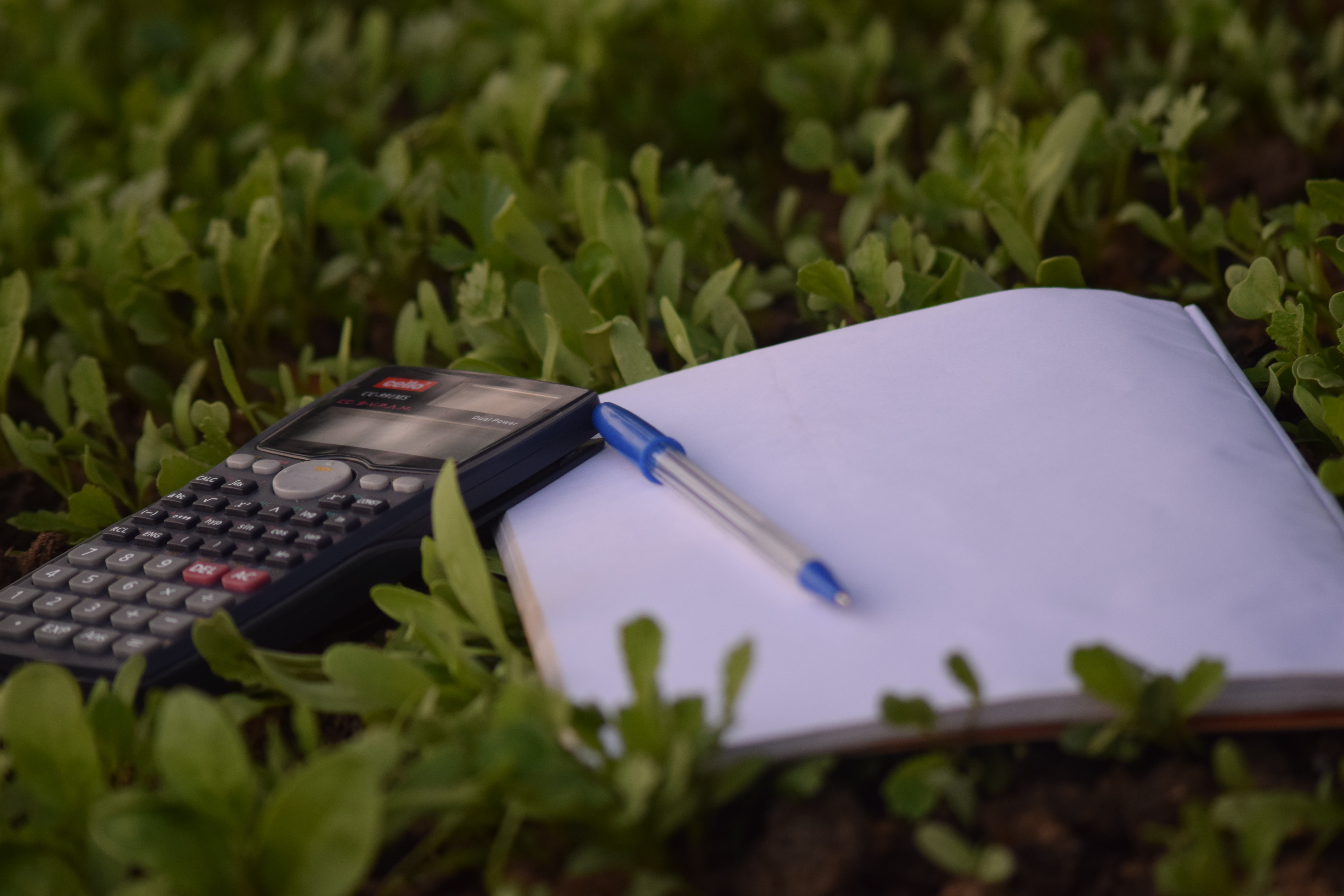 Calculator and pen and paper to make a budget