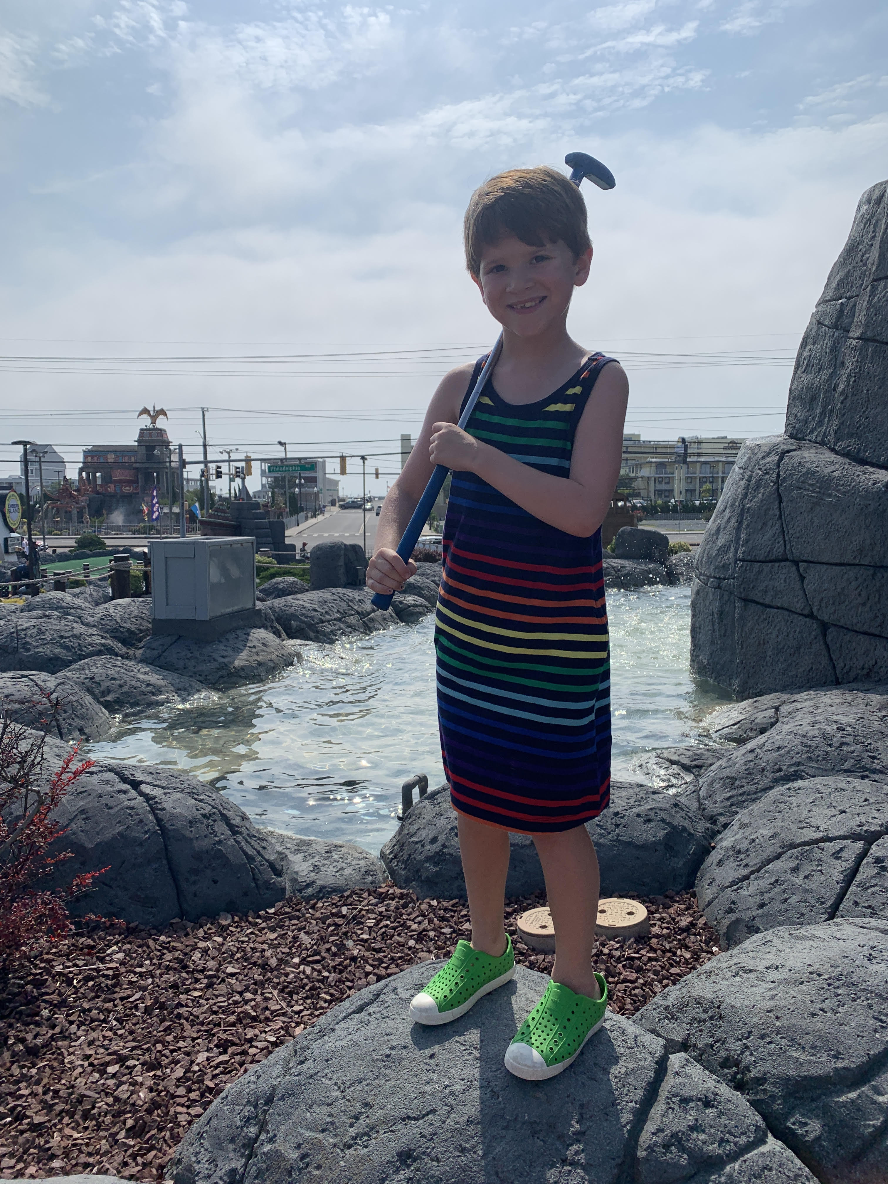 6 year old boy in sleeveless rainbow stripe tank top dress from primary