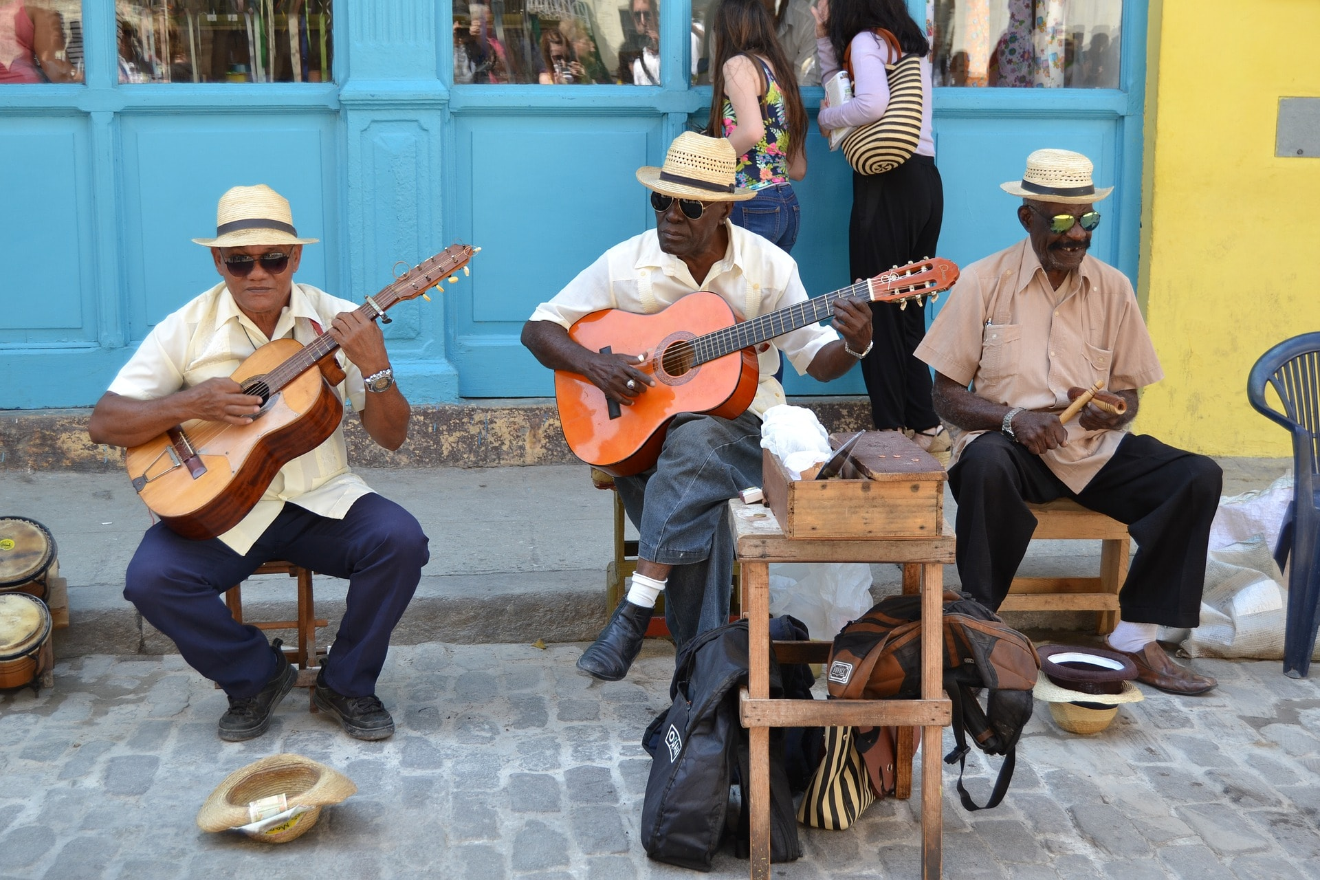 locals in cuba playing guitar