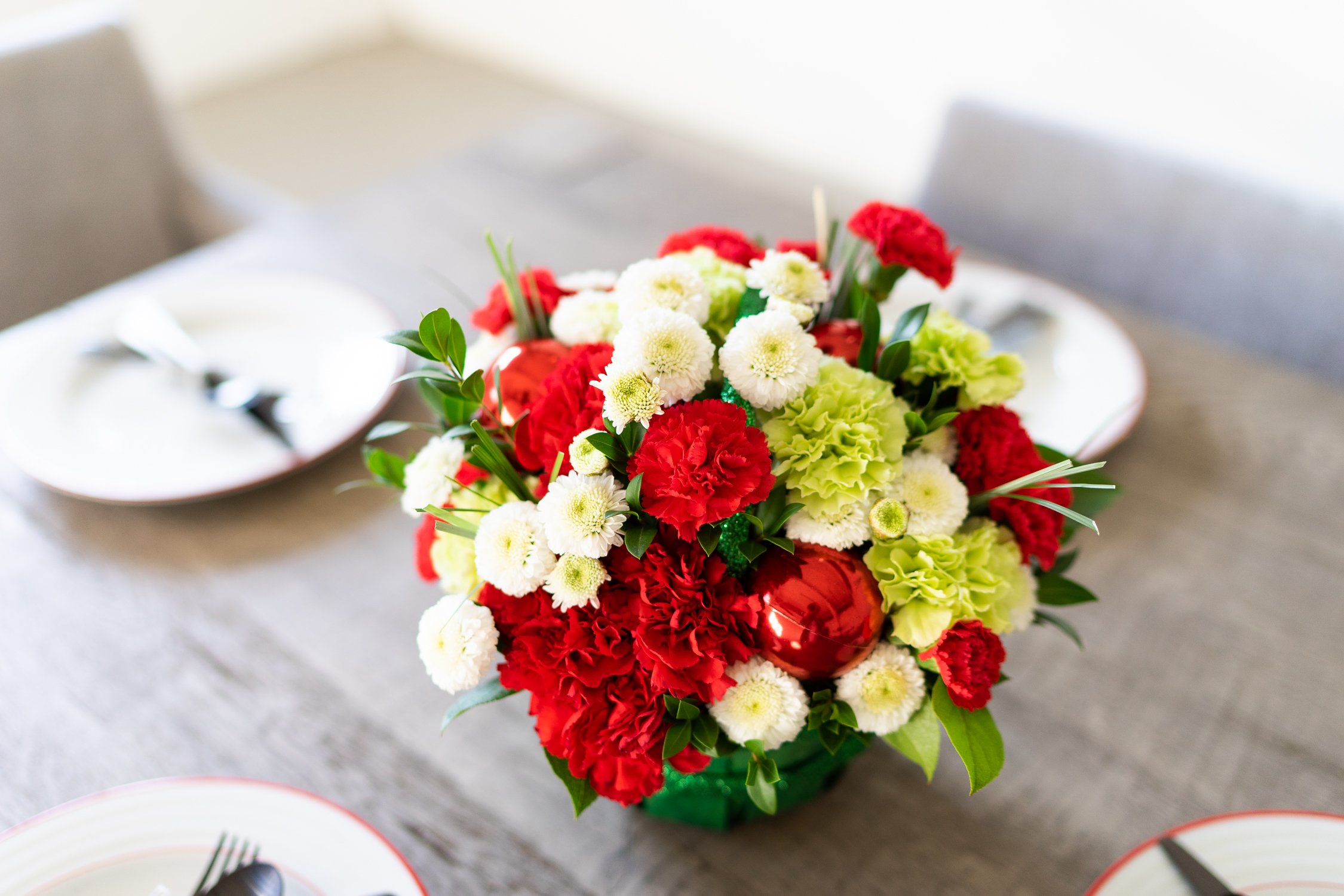 Holiday Centerpiece with Red, White and Green Flowers