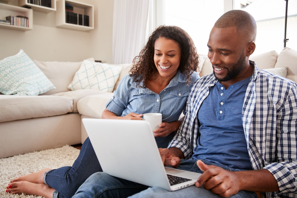 couple on laptop at home