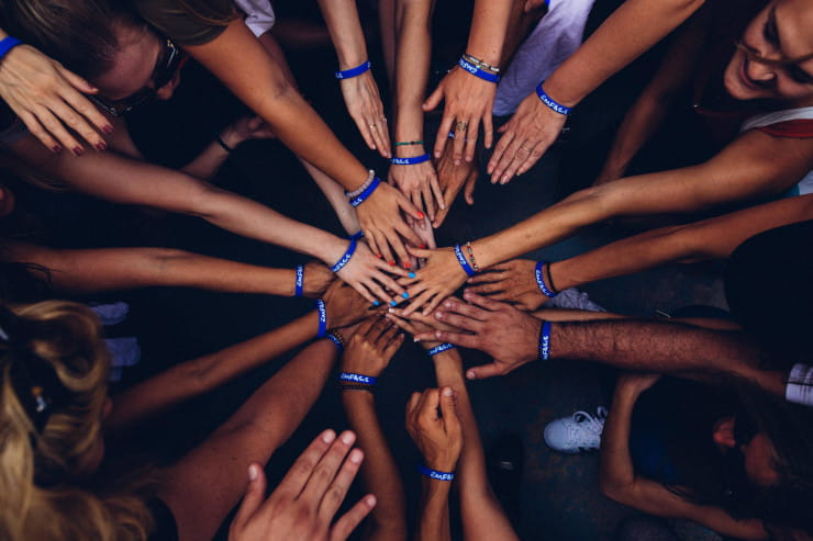 nonprofit team with hands together